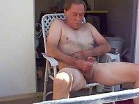 Mature pissing on the veranda