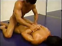 Oiled Guys Wrestling On The Floor