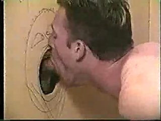 Swingering deepthroating through gloryhole