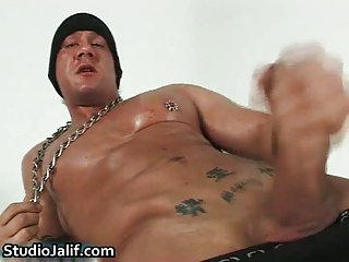Muscled gay hunk Rob Diesel jerking his cock