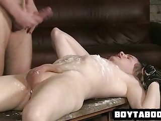 Tied up stud gets his cock tugged and takes some hot wax