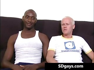 Interracial blowjob with muscled studs